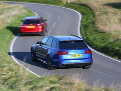 Audi corners well; AMG corners better...