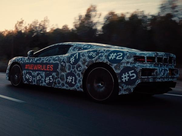 New Mclaren Grand Tourer teased in photos